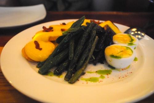 Papa a la Huancaina - potatoes, olives, egg, Huancaina sauce, green beans, bacon