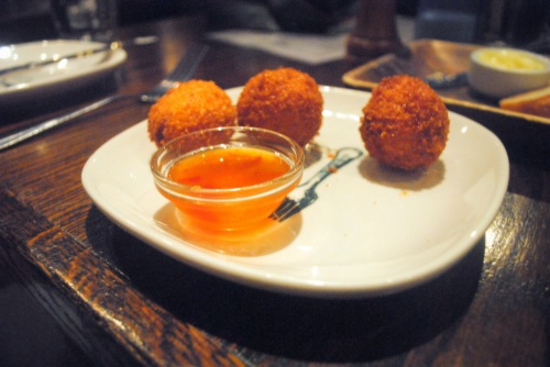 A potent appetizer: fried cheese grits w/ smoked cheddar & pepper jelly