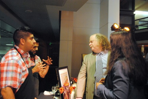Jonathan Gold speaking with chefs from Corozon Y Miel